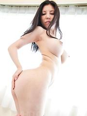 Sofia Takigawa fondles her generous jugs and fucks with dildos
