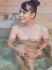Yui Oba Asian undresses and licks and sucks penis in bathtub