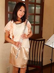 Slutty Yayoi Yanagida posing with her flute